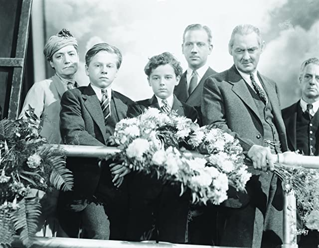 Lionel Barrymore, Freddie Bartholomew, Mickey Rooney, and Melvyn Douglas in Captains Courageous (1937)