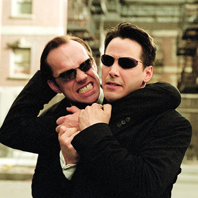 Keanu Reeves and Hugo Weaving in The Matrix Reloaded (2003)