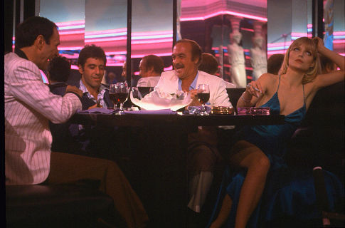 Al Pacino, Michelle Pfeiffer, F. Murray Abraham, and Robert Loggia in Scarface (1983)