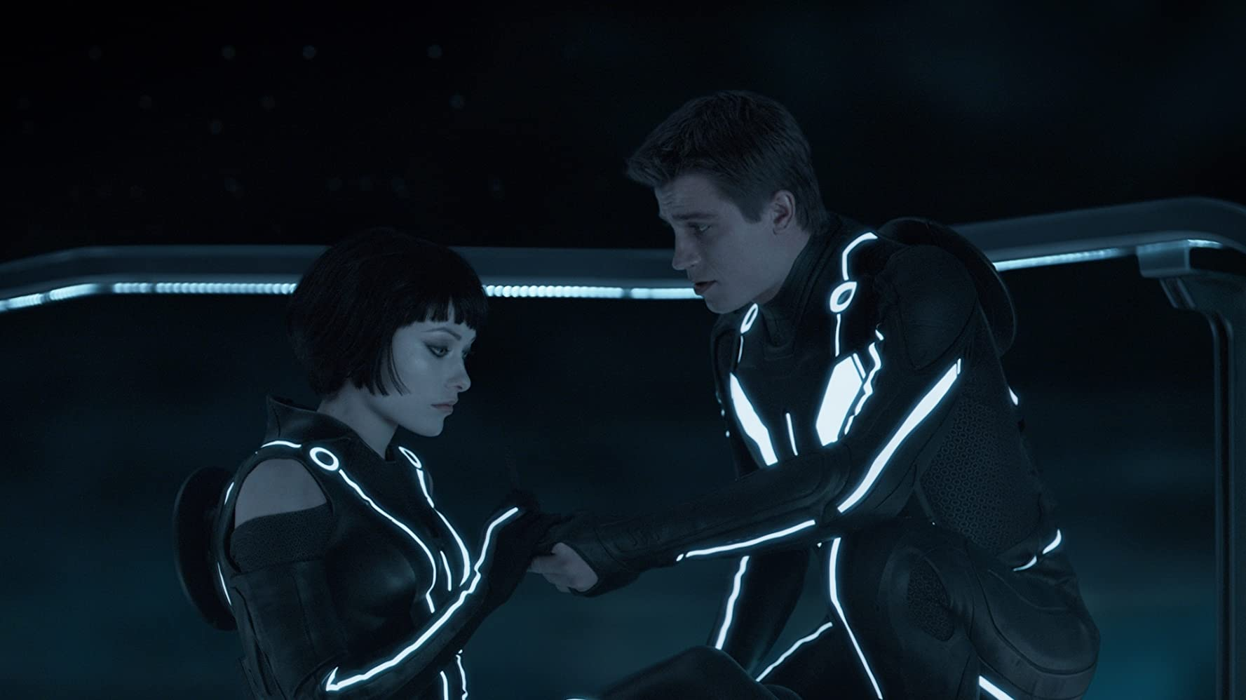 Olivia Wilde and Garrett Hedlund in Tron (2010)