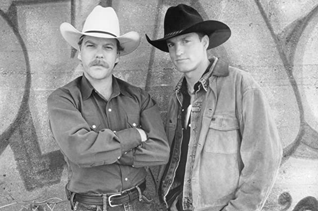 Woody Harrelson and Kiefer Sutherland in The Cowboy Way (1994)