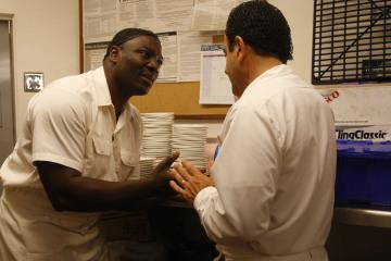 Tony Shalhoub and Adewale Akinnuoye-Agbaje in Monk (2002)