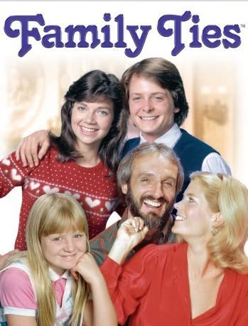Michael J. Fox, Justine Bateman, Meredith Baxter, and Michael Gross in Family Ties (1982)