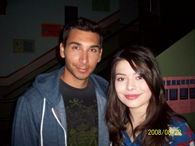 Gil Menchaca and Miranda Cosgrove on the set of ICARLY.