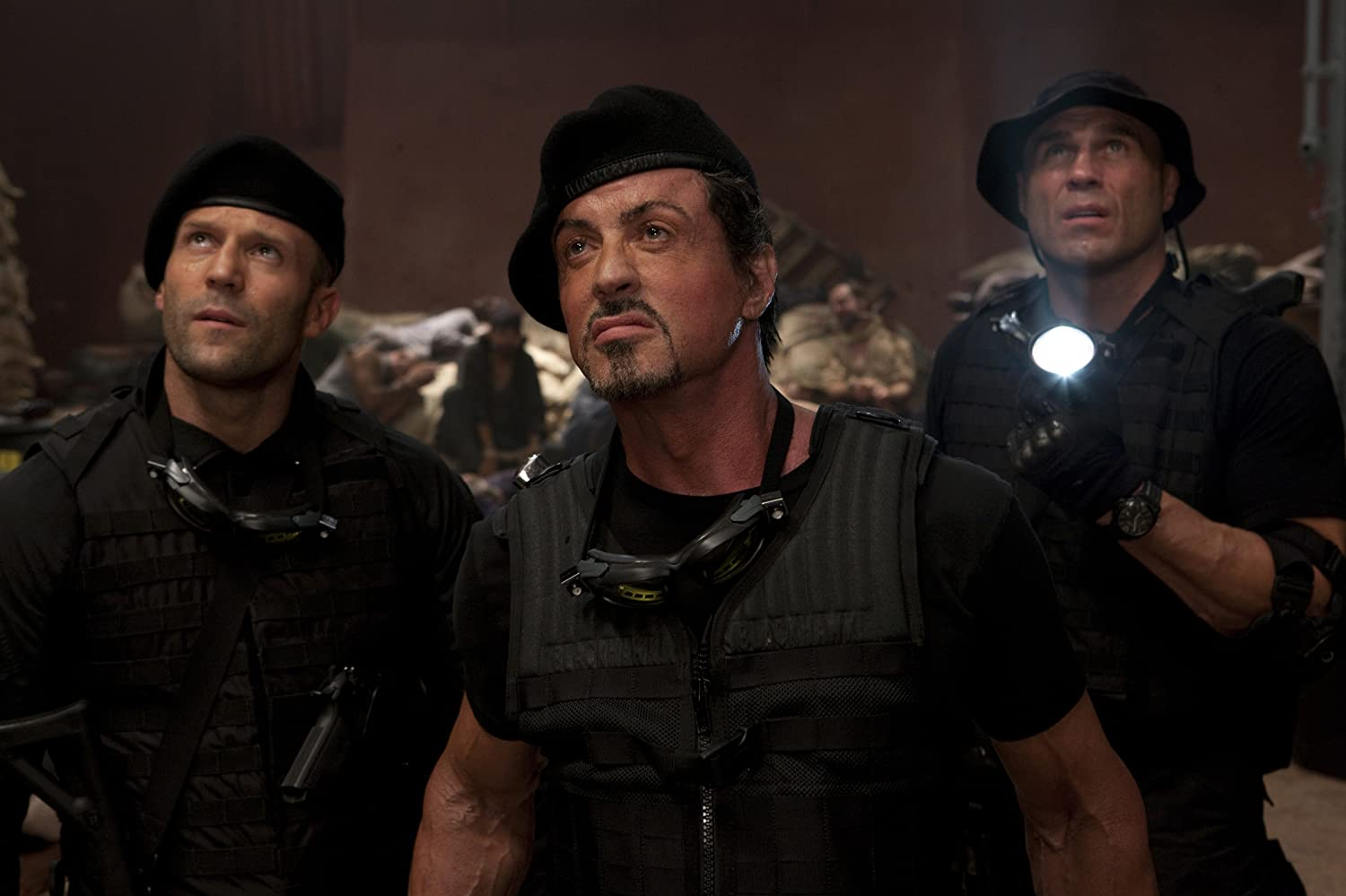 Sylvester Stallone, Jason Statham, and Randy Couture in The Expendables (2010)
