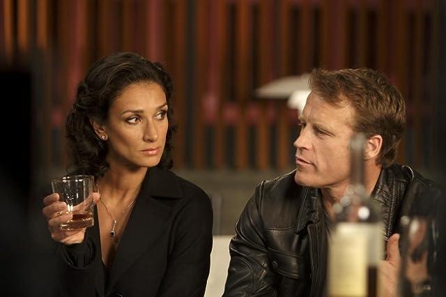 Mark Valley and Indira Varma in Human Target (2010)