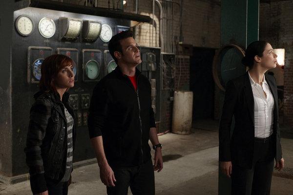 Eddie McClintock, Joanne Kelly, and Allison Scagliotti in Warehouse 13 (2009)