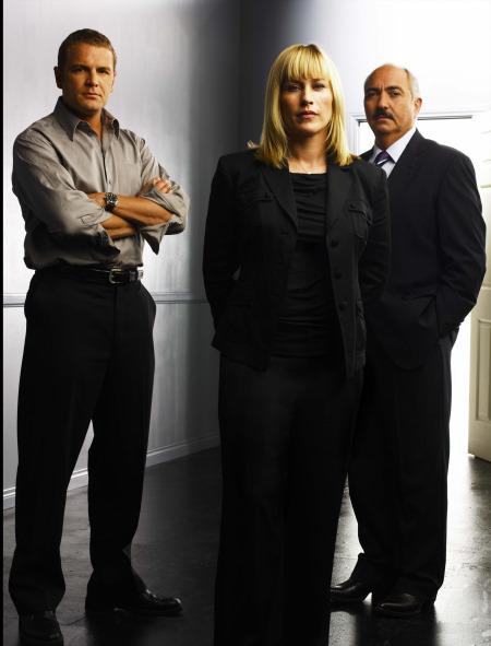 Patricia Arquette and David Cubitt in Medium (2005)