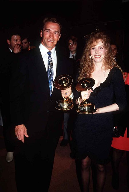 With ARNOLD SCHWARZENEGGER at Saturn Awards, Vivian accepting Best Picture for
