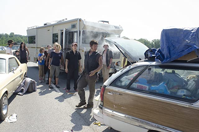 Norman Reedus, Jeffrey DeMunn, Laurie Holden, Andrew Lincoln, Melissa McBride, Sarah Wayne Callies, Steven Yeun, Chandler Riggs, and Madison Lintz in The Walking Dead (2010)