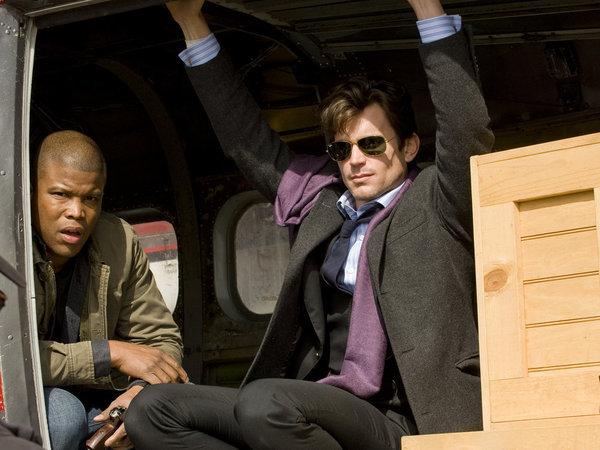 Sharif Atkins and Matt Bomer in White Collar (2009)