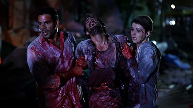 Andrea Osvárt, Eli Roth, and Ariel Levy in Aftershock (2012)
