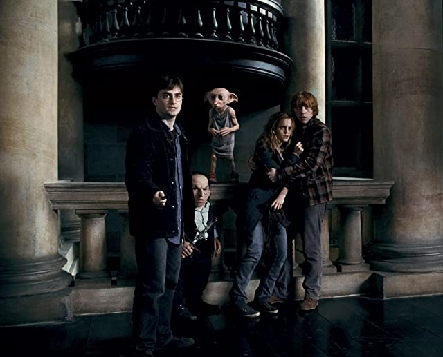 Warwick Davis, Rupert Grint, Daniel Radcliffe, and Emma Watson in Harry Potter and the Deathly Hallows: Part 1 (2010)