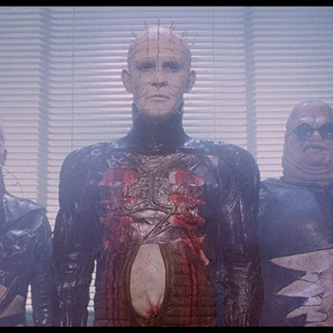 Simon Bamford, Doug Bradley, and Grace Kirby in Hellraiser (1987)