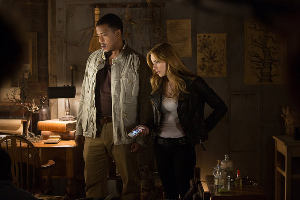 Russell Hornsby and Jaime Ray Newman in Grimm (2011)