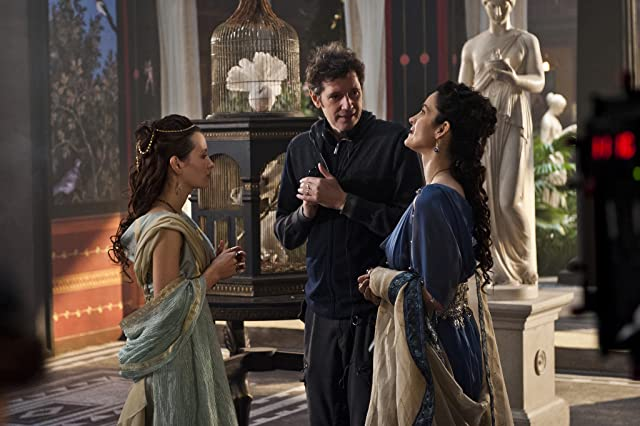 Carrie-Anne Moss, Paul W.S. Anderson, and Emily Browning in Pompeii (2014)