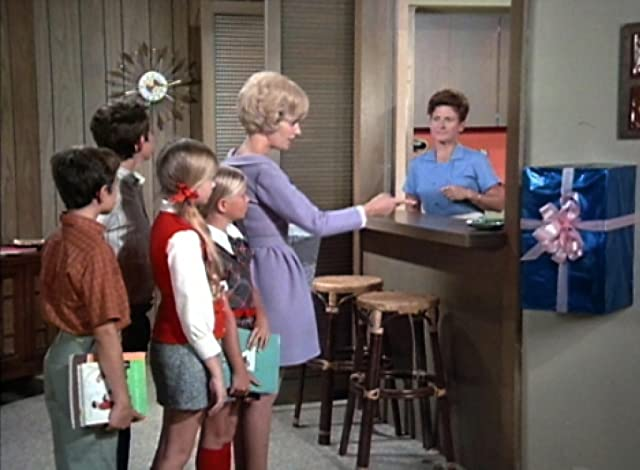 Eve Plumb, Florence Henderson, Ann B. Davis, and Christopher Knight in The Brady Bunch (1969)