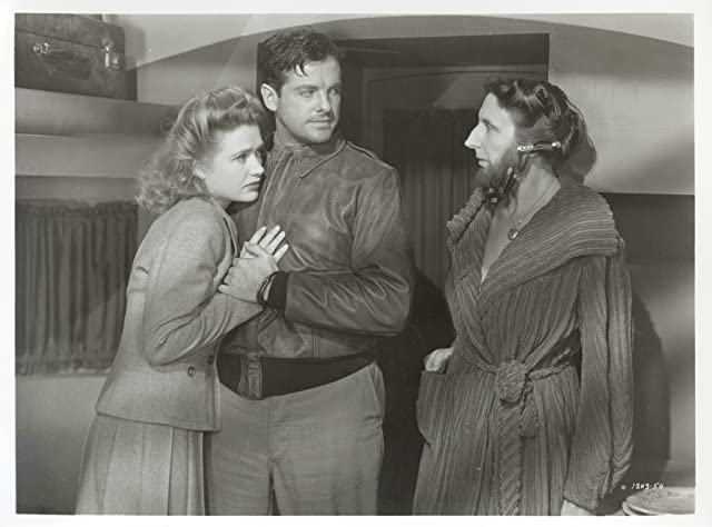 Robert Cummings, Priscilla Lane, and Anita Sharp-Bolster in Saboteur (1942)