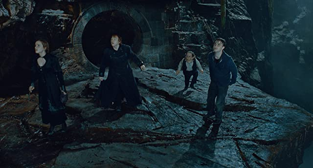 Warwick Davis, Rupert Grint, Daniel Radcliffe, and Emma Watson in Harry Potter and the Deathly Hallows: Part 2 (2011)