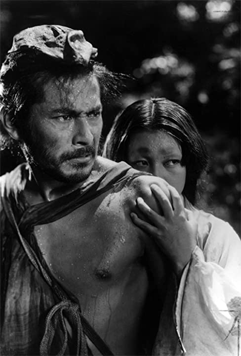 Toshirô Mifune and Machiko Kyô in Rashomon (1950)