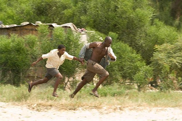Djimon Hounsou and Kagiso Kuypers in Blood Diamond (2006)