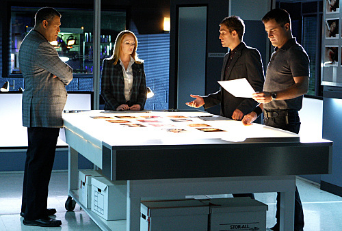 Laurence Fishburne, Marg Helgenberger, and Eric Szmanda in CSI: Crime Scene Investigation (2000)