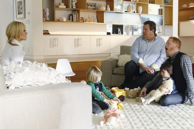 Rachael Harris, Jesse Tyler Ferguson, and Eric Stonestreet in Modern Family (2009)