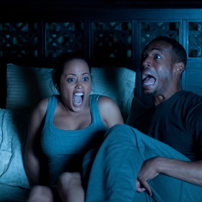 Marlon Wayans and Essence Atkins in A Haunted House (2013)
