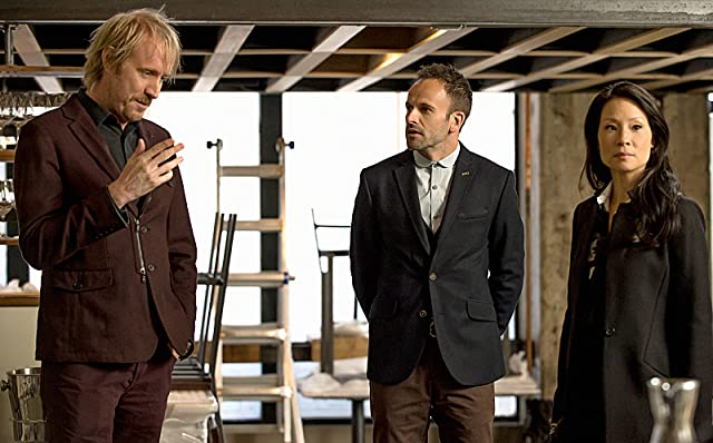Jonny Lee Miller, Lucy Liu, and Rhys Ifans in Elementary (2012)