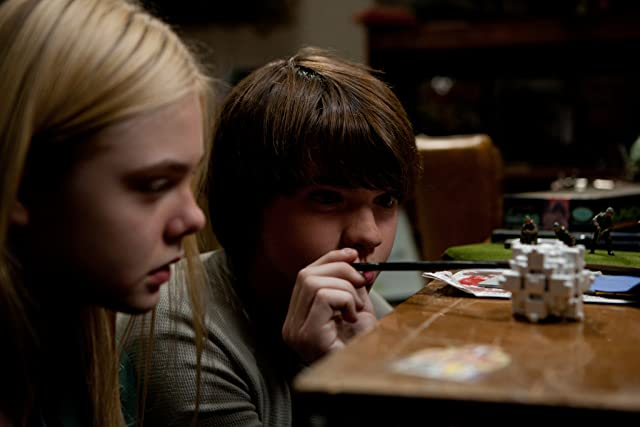 Elle Fanning and Joel Courtney in Super 8 (2011)