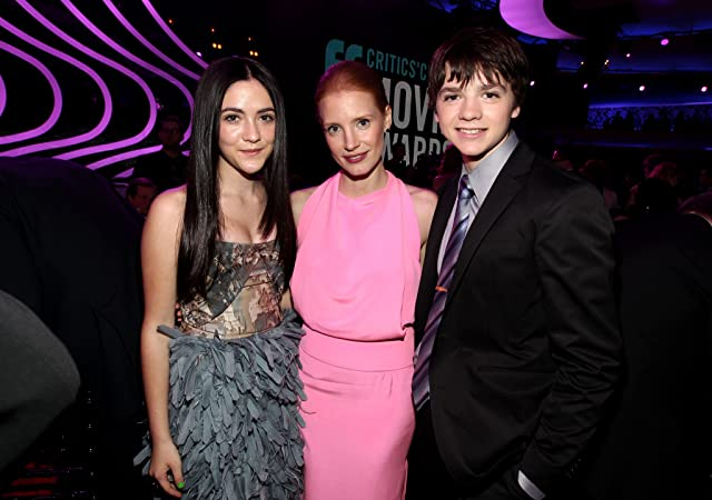 Joel Courtney, Jessica Chastain, and Isabelle Fuhrman