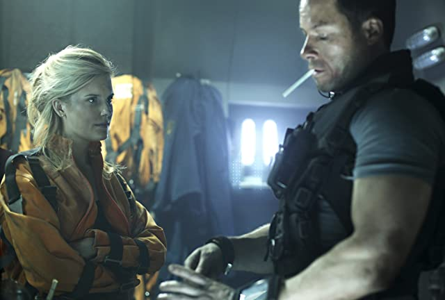Guy Pearce and Maggie Grace in Lockout (2012)