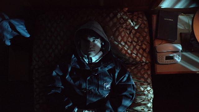 Adam O'Brian in The Imposter (2012)