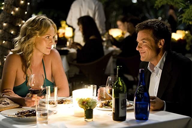 Charlize Theron and Jason Bateman in Hancock (2008)