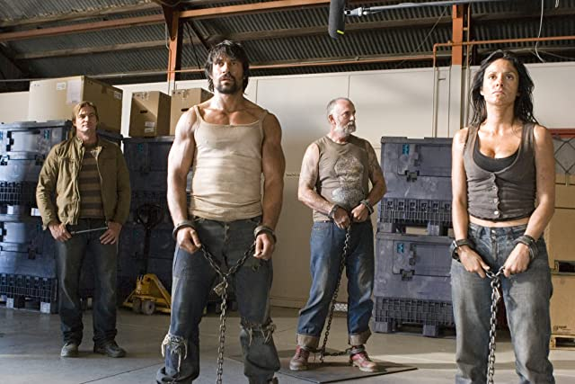 Manu Bennett, Andy McPhee, and Dasi Ruz in The Condemned (2007)