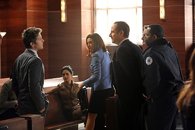 Julianna Margulies, Matt Czuchry, Archie Panjabi, and Sam Robards in The Good Wife (2009)