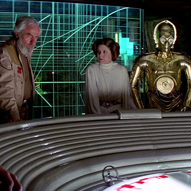 Anthony Daniels, Carrie Fisher, and Alex McCrindle in Star Wars: Episode IV - A New Hope (1977)