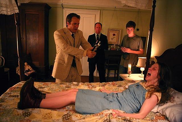 Ashley Bell, Patrick Fabian, Louis Herthum, and Caleb Landry Jones in The Last Exorcism (2010)
