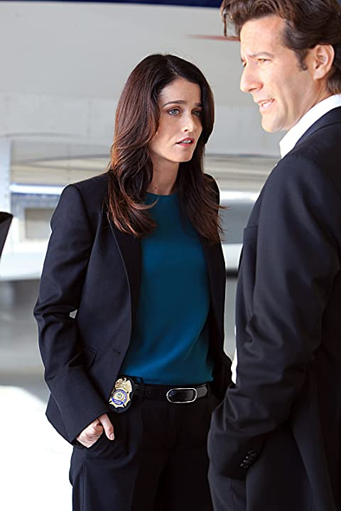 Robin Tunney and Henry Ian Cusick in The Mentalist (2008)