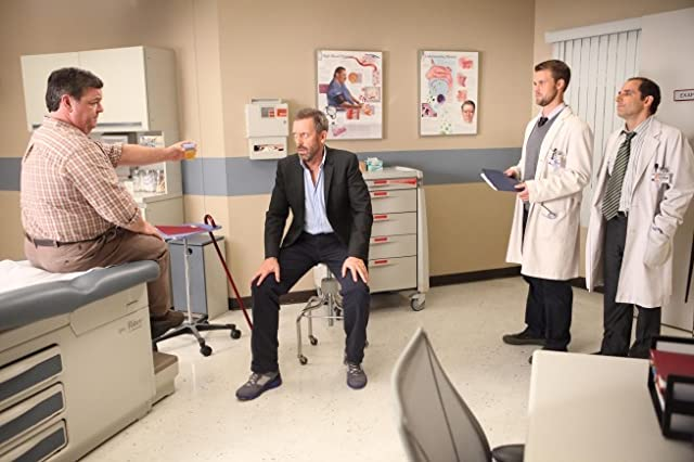 Peter Jacobson, Hugh Laurie, John Scurti, and Jesse Spencer in House M.D. (2004)