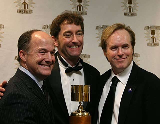 Best Feature winners Brad Lewis and Brad Bird surround presenter and event host Tom Kenny