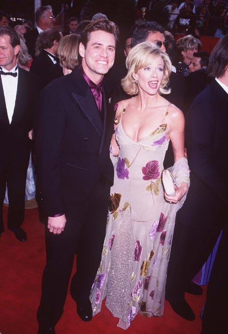 Jim Carrey and Lauren Holly at The 69th Annual Academy Awards (1997)