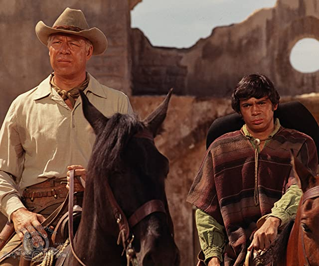 George Kennedy and Reni Santoni in Guns of the Magnificent Seven (1969)