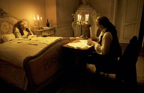 An ailing Mozart (TOM HULCE) dictates notes of music to Salieri (F. MURRAY ABRAHAM) who writes them down for him
