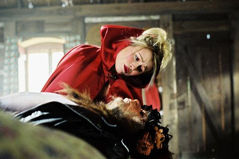 Mitsou Gelinas as Little Red Riding Hood and Marc Labrèche as The Big Bad Wolf in the Denise Filiatrault film ALICE'S ODYSSEY