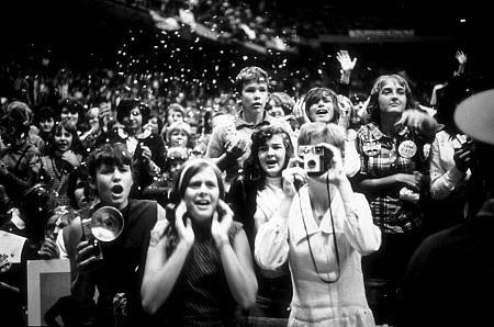 Beatles Fans enjoying the concert Beatles USA Tour. Confetti being thrown around