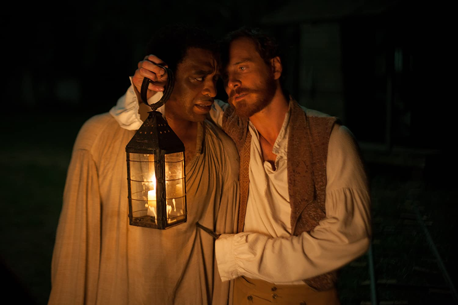 "Chiwetel Ejiofor as ""Solomon Northup"" and Michael Fassbender as ""Edwin Epps"" in 12 Years a Slave (2013) - Photo by Francois Duhamel - © 2013 Film4 Productions, London, England."