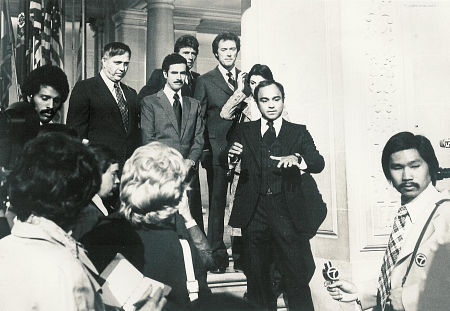 Going from left to right - lower left corner reporters (extras) unknown; upper left corner, African-American extra reporter unknown; John Crawford; Bradford Dillman; Harry Guardino; Clint Eastwood; Tyne Daley (behind Nick Pellegrino); Nick Pellegrino; Asian far right corner unknown