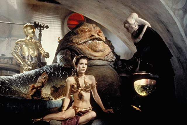 Anthony Daniels, Carrie Fisher, and Michael Carter in Star Wars: Episode VI - Return of the Jedi (1983)