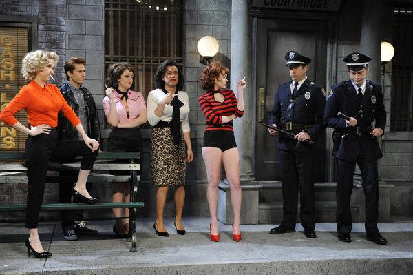Fred Armisen, Bill Hader, Lindsay Lohan, Jason Sudeikis, Kristen Wiig, Andy Samberg, and Abby Elliott in Saturday Night Live (1975)